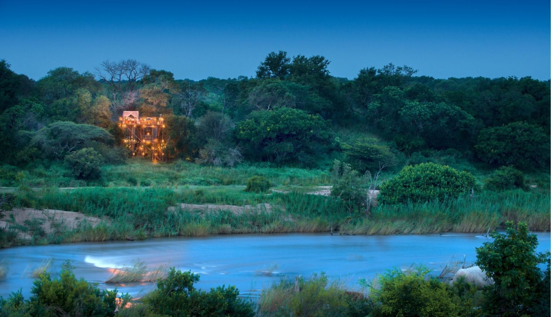 Lion Sands Tinyeleti Treehouse from across the river