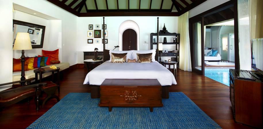 An Over water pool villa bedroom