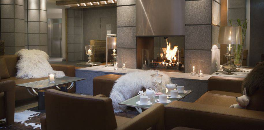 The lounge welcomes you with a log fire