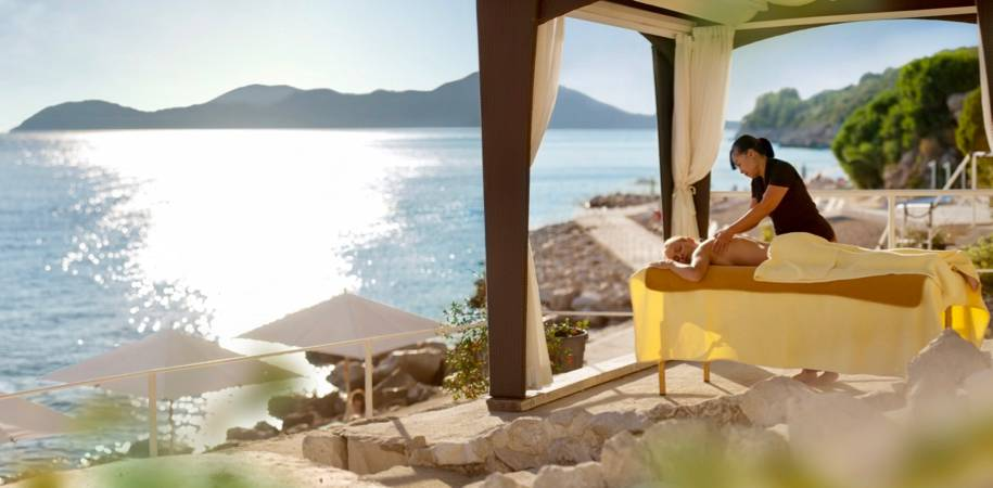 Relax with a beachside massage in the VIP area