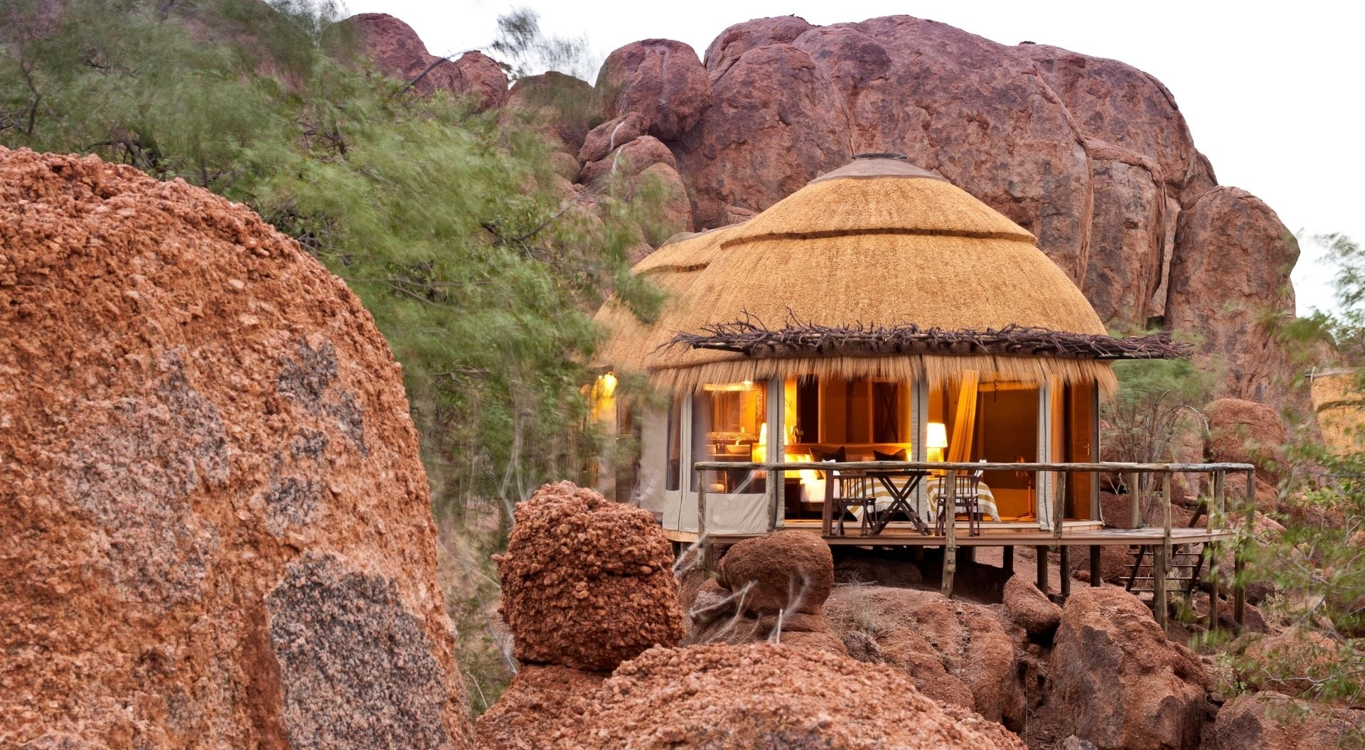 Thatched rooms are nestled amongst the boulders