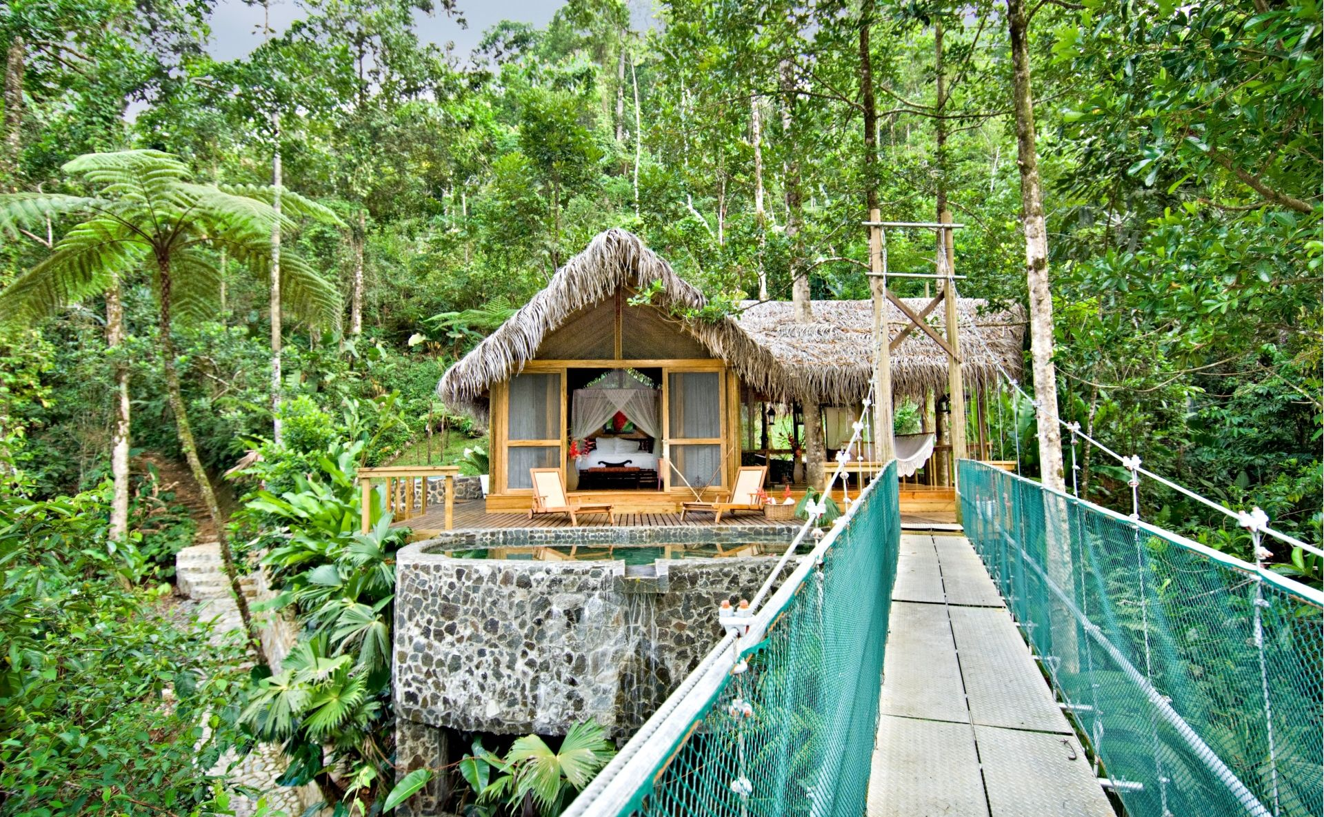 Pacuare Lodge Canopy Suite Exterior with suspension bridge