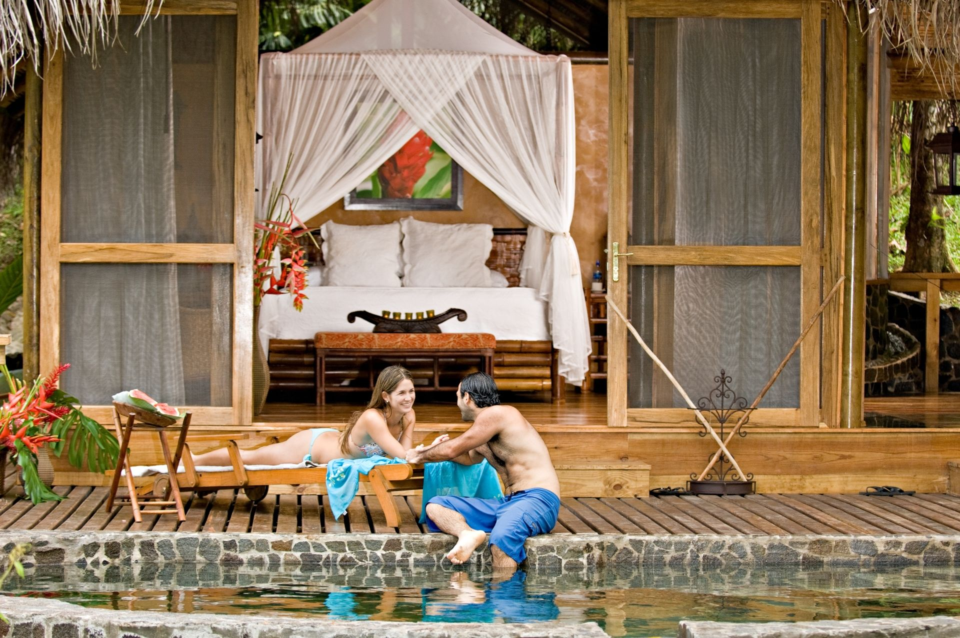 Pacuare Lodge Canopy Suite couple by pool