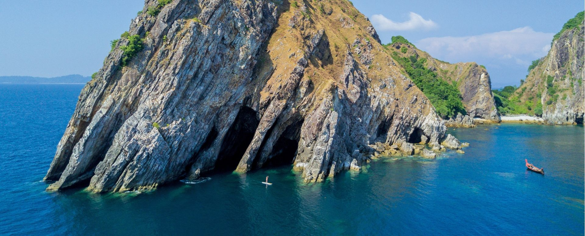 Explore the surrounding islands, beaches and caves